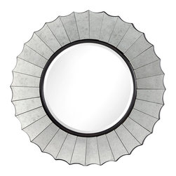Bedford Mirror - It may catch the light from the glistening sun, the twinkle of a candle at twilight, the glimmer of the moon glimpsed from a window. The Bedord Mirror boasts an antiqued mirror frame that heightens the reflective flair of this hand-cut mirror. A visually striking addition to a room in need of a dramatic accent piece or a touch of glamour.
