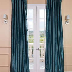 Peacock Vintage Textured Faux Dupioni Silk Curtain - Our Vintage Textured Faux Silk curtains & drapes have a slight sheen that mimics the finest texture of silk dupioni. These curtains bring the look of luxury without the cost or high-maintenance care. Built-in are two header designs within a single panel. The attached back tabs for a formal pleated look and a traditional pole pocket.
