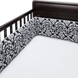Bananafish Taylor Crib Sheet - Sweet and simple, the Bananafish Taylor Crib Sheet is a wonderful accenting sheet for both girls and boys. This cozy crib sheet features a black and white polka dot pattern that is printed on 100% cotton. Fitting most standard crib mattresses, this crib sheet is quickly cleaned my machine washing cold.About BananafishBananafish was founded in 1997 and has grown to become a leading manufacturer of infant bedding and nursery décor. In 2007 Bananafish became part of the Betesh Group family. Bananafish has found success tapping into global design resources to bring the latest trends to their product lines. While on-trend, they still manage to balance a look that appeals to classic and contemporary tastes. You'll find Bananafish products featured in all the hot media, such as Pregnancy Magazine, American Baby, HGTV.com, OK Pregnancy and Newborn, and more. Luxurious comfort, superior quality, and style that lasts, Bananafish will help you create a nursery that delights.