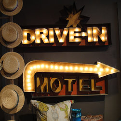 "Drive-In Lighted Sign - Transform your home theatre into a vintage drive-in with this unique sign. Hand painted and distressed each sign comes with strand of 25, C-9 clear bulbs. Some assembly is required. Can be used indoors or out.  Add a wonderful rustic look to your home and gardens décor with hand crafted aged metal roadside signs and letters. Dimensions: 48""w x 5""d x 24""h"