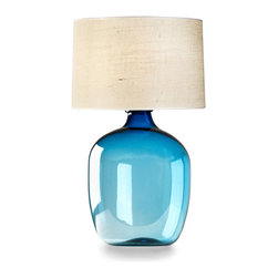 Poseidon Blue Lamp - Vivid marine blue suffuses the glass of the Poseidon Round Vase, intensifying toward the neck of the bottle-shaped base to make a statement rooted in artisan techniques and the vintage taste for blue glass. This brighter, more eye-catching take on the classic accent color is perfectly suited for use in task lighting and sets a bright, interesting mood in your transitional room.