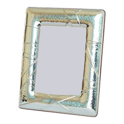 "Silverstar International - 3.5""x5"" Remy Silver Sterling Frame - Interior decorators & interior designers love the modern asymmetrical triangular embossed designed of the 925 sterling silver Remy picture frame. Designed and manufactured by Silverstar International, this picture frame is accented by a veneer mahogany wood backing that is as easy to open as it is to secure and features atarnish resistant surface for easy cleaning and glare resistant glass."