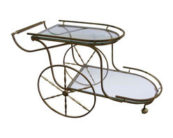 Used Fantastic Hollywood Regency Italian Brass Bar Cart - An outstanding Hollywood Regency Italian brass bar cart, perfect for holiday entertaining! It features solid brass construction with gorgeous detail; this piece will be a showstopper at your party! The cart features large wheels for easy movement and an elongated lower tier for extra storage space. Fantastic design and style!