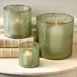 Sea Glass Candleholders - Set of 3 - Bring home a feeling of tranquility, serenity and calm with the help of this lovely set of three Sea Glass Candleholders. Fill these gorgeous green vessels with candles and illuminate your master bath with the soft lighting candles bring into a room. A stack of freshly washed towels, a cool glass of cucumber water and these hand blown glass canisters set the stage for a home spa experience that is indulgent and relaxing.