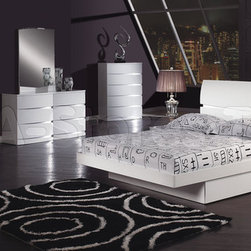 5 PC Aurora White Glossy Bedroom Set - This elegant Aurora White Glossy Bedroom Set will upgrade the look and feel of any bedroom. The pure white finished bed features sleek design, curved accents on the headboard and a spacious storage drawer. Each nightstand combines both grace and practicality featuring 2 spacious storage drawers and its white finish is enhanced by solid construction, bowed accent. The Dresser features contemporary style and design providing plenty of storage space and it is is enhanced by solid construction. The Mirror beautifully reflects light and expands your room's visual space. The refreshing white finish of the set will make your room look up-to-date and amazing.