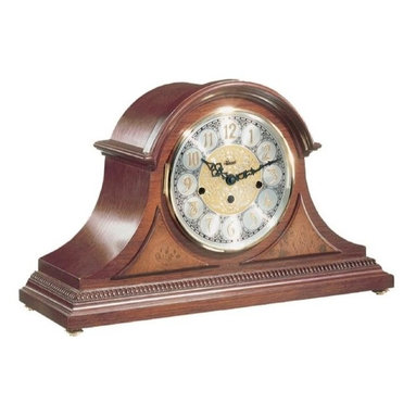 Hermle Clocks - Amelia Tambour Style Mantel Clock in Elegant Cherry - Impressive dimensions and classic beaded trim lend added warmth to this tambour style mantel clock. It has a white, black and embossed gold-tone dial, with easy to read Arabic indicators. Short brass feet give this clock exceptional stability on any surface. Elegant Cherry Finish. Diamond turned chapter ring dial. Raised Arabic numerals and embossed center. Brass feet. Raised burl veneer panels. Beaded molding across the bottom. 8-Day Brass key wound movement . Plays Westminster melody. Listen to the chimes!. 18.13 in. W x 6.5 in. D x 11.38 in. H
