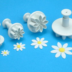 None - Plunger Cutter Set 4 Pieces-Daisy Marguerite - Plunger Cutter Set. These cutters are ideal for use with a wide range of edible and non-edible materials including: pastry; cookie dough; sugar paste; petal paste; marzipan or craft clays. Design: Daisy Marguerite.