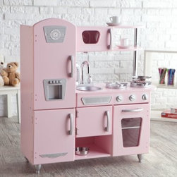 KidKraft Pink Vintage Kitchen - You're cookin' up some fun now! The KidKraft Pink Vintage Kitchen is a marvel of imagination ready for your little Julia Child. Silver knobs turn and click cabinet and oven doors open and close you can peek into the oven to check on your soufflé. There's even a cordless phone on the wall in case the Food Network calls. The silver sink comes out for easy cleaning. Made from sturdy MDF wood construction with a hard finish that can handle both real and imaginary spills. KidKraft products are backed by a full one year guarantee. Assembles easily with instructions and all hardware included. That retro pink is oh-so-authentic isn't it? About KidKraftKidKraft is a leading creator manufacturer and distributor of children's furniture toy gift and room accessory items. KidKraft's headquarters in Dallas Texas serves as the nerve center for the company's design operations and distribution networks. With the company mission emphasizing quality design dependability and competitive pricing KidKraft has consistently experienced double-digit growth. It's a name parents can trust for high-quality safe innovative children's toys and furniture.
