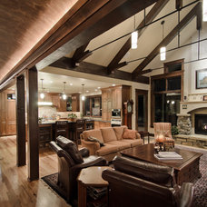 rustic living room by Aneka Interiors Inc.