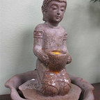 "Tabletop Fountain, Indoor Fountains - The ""Kneeling Buddha""  tabletop fountain  is made of a durable and lightweight poly-resin but with a ceramic look finish. Includes a pump and an LED light illuminating the water flow."