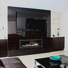 Modern Indoor Fireplaces by NYC Fireplaces and Outdoor Kitchens