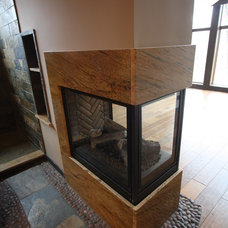 Rustic Indoor Fireplaces by Architectural Justice