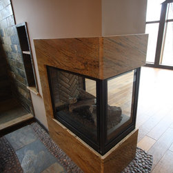 Three Sided Fireplace - Flooring by Architectural Justice