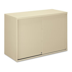 HON - HON Overfile Storage Cabinets - 42 x 18 x 27.9 - Steel - 2 x Shelf(ves) - Brigade Metal Overfile maximizes use of space above lateral files and is compatible with HON Flagship and Brigade 800, 700, 600 Lateral Files. Easily fasten onto lateral file cabinets to store binders, manuals and other items. You can attach it to the wall behind a lateral file, or gang two overfiles together for added stability. Putty-colored overfile can also be used on the floor under 29-1/2 high work surfaces. Design includes two shelves, four wire dividers per shelf, a core-removable lock and fastening hardware. One shelf is adjustable at 1 increments up to 6 from the center position. Overfile has locating slots every 3 along the shelf and base. Depending on the location of the adjustable shelf, the overfile is capable of accepting two tiers of 12 high binders. Slide-by door design does not intrude into office or aisle space.