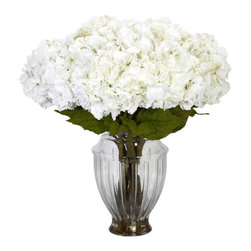Large Hydrangea with European Vase Silk Flower Arrangement - Like a soft, billowy cloud on a lazy summer day, this stunning recreation of a Large Hydrangea has an almost dreamlike quality. Perhaps it's the full blooms that sit atop the bed of lush greenery; or the considerable stems that proudly stand straight, doing the heavy lifting while the flowers rest above. Or perhaps it's all of these, tucked away in a large Grecian vase. Either way, it's the perfect piece for beautifying any area. Height= 30 in x Width= 30 in x Depth= 30 in