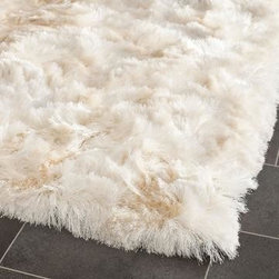 Safavieh - Safavieh Shag 500 SG511-1212 8' x 10' Ivory Rug - The Safavieh Shag Collection, with its soft, luxurious deep pile, is the perfect, modern accent for your home. The sturdy cotton backing and rich, high-density acrylic fabric will ensuring high durability and a long life. The warm colors and soft feel make this the perfect rug to fill that empty space in your home.