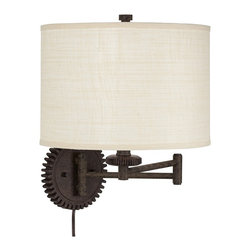 """Kathy Ireland - Industrial Kathy Ireland Livingston 15 1/2""""H Swing Arm Wall Light - From the Kathy Ireland Home collection comes this handsome Livingston swing arm wall lamp. The design features an adjustable arm with a gear shaped backplate. The poly dark rust finish on the arm and backplate gives the appearance of a long history and also complements the drum shade. With a generous 23"""" arm swing this industrial wall light is the perfect choice above a nightstand or next to a reading chair. Easy to install this design plugs into any standard outlet. Swing arm wall lamp. Poly dark rust finish. Industrial gear backplate accent. Takes one 100 watt medium base bulb (not included). Plugs into any standard outlet. 15 1/2"""" high. 23"""" arm extension. Shade is 12"""" across the top 12"""" across the bottom 8 1/2"""" high.  Swing arm wall lamp.  Poly dark rust finish.  Industrial gear backplate accent.  Takes one 100 watt medium base bulb (not included).  Plugs into any standard outlet.  15 1/2"""" high.  23"""" arm extension.  Shade is 12"""" across the top 12"""" across the bottom 8 1/2"""" high."""