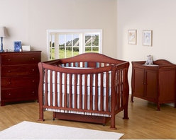 DaVinci - Parker Three Piece Convertible Crib Nursery Set with Toddler Rail in Cherry Pine - A convertible crib set with an elegant swooping front. This grand-standing crib features a solid front side with no moving parts and is designed for mothers to take their little ones out of the crib with little effort. A day bed conversion guard rail, full size headboard and footboard complete the bed. The adjustable, three level mattress spring system accomodates your baby's growth. Additional trundle drawer is included for added storage space on the bottom. This crib set also comes with the two-door changer which has plenty of space for all your baby's essentials. Features: -Parker Crib, Toddler Rail, Crib Trundle, Parker 2 Door Changer & Parker 4-Drawer Dresser included in set. -Convertible Crib: converts from crib, toddler bed, daybed, full bed -Toddler rail included. -Trundle drawer included for extra storage space underneath -Constructed from New Zealand Radiata Pine Wood -Assembly required -Included is the two-door changer with ample storage space -Optional, matching four-drawer dresser available -Optional full size rail kit conversion kit -This is a NON-Drop Side crib. About New Zealand Radiata Pine Wood: Radiata Pine, better known as 'New Zealand Pine' is a softwood tree that contains many properties that make it very suitable for furniture and furniture making. It has a density equal to that of hardwoods like poplar, mahogany and oak. Its uniform density ensures a smooth and consistent texture and confers its excellent machining, painting and staining properties; there is almost no variation in color between pieces. DaVinci's pine wood originates from forests maintained by managers that enforce environmental responsibility and the conservation of forest wildlife. ***Please note that these products cannot be shipped to Alaska, Hawaii, or Puerto Rico. We apologize for the inconvenience - feel free to call us regarding alternatives! This Crib is approved for use in th