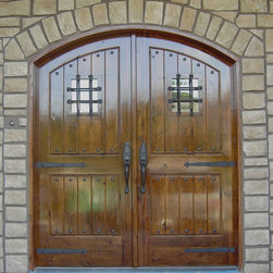 Knotty Alder arched, double door entry. - Knotty Alder arched, double door entry with plank style panels.  Features wrought iron clavos, decorative strap hinges and speakeasy windows with wrought iron grills.