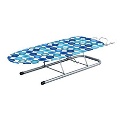Minky Homecare - Minky Homecare Table Top Ironing Board Multicolor - HH41200107V - Shop for Ironing Boards from Hayneedle.com! Unfortunately not having a separate laundry room doesn't equate to not having laundry; the Minky Homecare Table Top Ironing Board allows you to dress like a professional at a moment's notice even if you don't have a full facility at your disposal. Ideal for apartments condos and utility rooms this small ironing board doesn't sacrifice features for convenience. This ironing board gives you the ability to be the well-dressed person you envision without requiring an entire room devoted to it. Compact and fully collapsible this board nevertheless comes with impressive features that help turn a tiresome chore into a quick enjoyable part of getting ready. The sturdy yet lightweight construction allows for quick and easy set up and removal. And the rubber feet will grip any surface surely without leaving scratches or marks behind. The retractable iron rest also allows you to set your iron down between garments without having to worry about it getting in the way or accidentally damaging your table tops.About Minky HomecareWith a history that stretches clear back to the mid-nineteenth century Minky Homecare has the experience and integrity to ensure that your housework is quick and easy. Part of Vale Mill Minky Homecare is a family owned and run business which means personal care and commitment to developing the very best cleaning products on the market. From prepacked cleaning cloths to ironing boards from air driers to household cleaners and organizers Minky has been on the cutting edge of homecare for over half a century. As a result they have grown into international markets and have even been granted a warrant by the British Royal Household. With Minky Homecare housework is a pleasure and does itself when you don't want to.