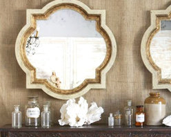 Eloquence Lyon Mirror - The trefoil-esque shape of this beautiful mirror is what originally caught my eye, but the gold and pearl colorings offer an antiqued glamour to a space.