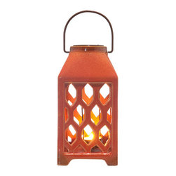 Orange 4-Sided Lantern - The 4-sided ceramic lantern will warm your patio and bring a burst of color to your interior decor. Covered in a rich orange glaze, the lantern's perforated design displays candlelight in delicate geometric patterns.
