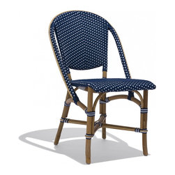 Industry West - Monaco Side Chair - The Classic European Bistro Stool crafted with a modern twist. The time honored technique of molding and stretching rattan into its shape, perfected by the French in the 1930's, gives this stool its beautiful, organic aesthetic. This featured color blends a dark blue with crisp white and is perfect for any exterior or interior application. Rattan is one the only sustainable material harvested in nature and used for furniture application without any processing. The recycled polystrand weave is UV and weather resistant and will not loose elasticity even under heavy use.