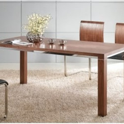 Baron Dining Table - Sleek and chic, the Baron Dining Table elevates your dining experience. This table is made of walnut veneers in a rich walnut finish. A stainless steel stripe surrounds the base of the table top for a modern feel. This table seats six in style. About Whiteline:With a product line that includes prime leather sofas, comfortable beds, and elegant dining room furniture, Whiteline delivers modern and contemporary styles along with cozy comfort. Whiteline has 15 years of experience building furniture, along with a worldwide network of skilled manufacturers to help them give you the best value for your money. And their huge collection of designs is sure to have something to suit your contemporary tastes.