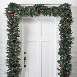 "Frontgate - Classic Pre-lit Christmas Garland Christmas Decor - The garlands measure 14"" wide. Three garlands can be connected together and plugged in a single outlet. With Clear, Multicolor or Christmas Classic lights (red, green and frost). Suitable for indoor and outdoor use. To maximize fullness, greenery will need to be shaped. Set the outdoor holiday scene in an instant with pre-lit garlands and wreaths brimming with a mixture of greenery that's amazingly full and realistic. Life-size sprays of Scotch pine, pistol pine, noble fir, large pinecones, and bundles of ruby red berries are pre-lit with long-burning, 3,000-hour lights.  .  .  .  . . 6 ft. cords ."
