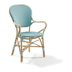 Frontgate - Set of Two Paris Outdoor Bistro Outdoor Armchairs - Chair frame is handcrafted of natural bent rattan. Polystrand fiber weave withstands the effects of rain, snow, salt water and sun. Rattan frame will weather to a silvery patina over the course of a year; to preserve its original look, rub with linseed oil. Ideally suited for a balcony, deck or under an arbor. Complete the look with our classic Paris Bistro café table. Create the allure of a French sidewalk cafe with our charming and comfortable Paris Bistro Dining Chairs. These colorful chairs derive their authentic look from strong bent rattan frame and a neatly handwoven, all-weather seat and back.  .  .  .  . Complete the look with our classic Paris Bistro cafe table . Imported.