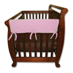 Trend Lab - Trend Lab Rail Cover - Short Pink Fleece - 109050 - Shop for Crib Bumper Pads from Hayneedle.com! Protect your crib and more importantly your baby with the Trend Lab Rail Cover - Short Pink Fleece. The convertible crib rail cover is made from super-soft Sherpa fleece so it's safe for your baby and it protects the crib from teeth marks. Plus it's lightly padded with a waterproof layer so it will last. Just wrap and tie it to secure it to the crib rail. The pink color is perfect for your little girl. Trend Lab will replace any defective products within 30 days of original purchase. Dimensions: 27L x 18W x 1H inches.About Trend LabBegun in 2001 in Minnesota Trend Lab is a privately held company proudly owned by women. Rapid growth in the past five years has put Trend Lab products on the shelves of major retailers and the company continues to develop thoroughly tested high-quality baby and children's bedding decor and other items. With mature professionals at the helm of this business Trend Lab continues to inspire and provide its customers with stylish products for little ones. From bedding to cribs and everything in between Trend Lab is the right choice for your children.