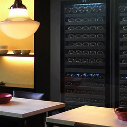 Vinotemp - Dual-Zone Touch Screen Wine Cooler - Floor standing. Made from glass and steel. Black color. Fits approximately 142 bottles. Includes security lock and key. 23.5 in. W x 26.75 in. D x 69 in. H (249 lbs.). 3-5 days lead time. Touch screen controls. Digital controller with blue LED readout. Dual-zone wine cooler with 15 sturdy pull-out metal shelves. Front exhaust allows the unit to be built-in or freestanding. Sleek and contemporary design. Warranty