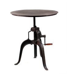 Carnegie Industrial Bar Table Metal Top - The Carnegie Industrial Bar Table with Crank features a sturdy three point base and a durable iron top or wood that's adjustable from 34 inches to 45 inches. It's factory inspired look pairs well with any of our seating. Available with either a distressed steel or wood top.