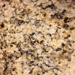 Granite 101 - Venetian Gold is a nice Group 1 Granite that goes well with several cabinet choices.