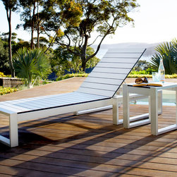 Outdoor Furniture Collection - Peron daybed in white laminate with brushed Stainless steel frame shown with Peron low side table