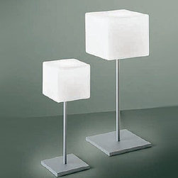 ITRE - Cubi table lamp - The Cubi table lamp from ITRE has been designed by Ufficio Stile/Tre in 2000. This table mounted luminaire is great for halogen lighting. The Cubi is composed of a white satin finished diffuser made of layered and blown glass. The structure of this light is constructed of grey polycarbonate. The Cubi  table lamp exhibits an brilliant and practical design, along with quality craftsmanship, that is sure to beautifully brighten any contemporary domain.
