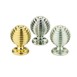 "1"" Retro Cabinet Knobs - This round cabinet knob features retro looking ripples that bring images of 50's diners to mind; and since it is available in 3 finishes, you'll be sure to find a color that matches your home decor.  Priced and pictured in polished brass."