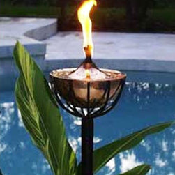 Maui Tiki Torch - The Maui Tiki Torch head is cradled by a black steel holder that sits on a pressure-treated solid wood pole with a pointed end for easy in-ground installation. The finish of the torch will not change over time.