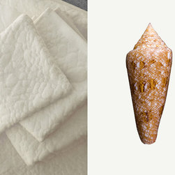 """Affina - Gloriamaris Bath Towel Set - Conus Gloriamaris, also known as the """"Glory Of The Seas"""" was regarded for centuries as the rarest shell in the world. This sea snail's conical shell features an intricate geometric pattern; ours comes from a shell discovered near the Balicasag Island in the Philippines."""