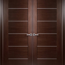 "Contemporary African Wenge Interior Double Door with Aluminum Strips - SKU#    Maximum-201-Wenge-2Brand    BELWOODDOORSDoor Type    InteriorManufacturer Collection    Modern European Interior DoorsDoor Model    Door Material    WoodWoodgrain    African WengeVeneer    Natural African Wenge Wood VeneerPrice    920Door Size Options    2(18"") x 80"" (3'-0"" x 6'-8"")  $02(20"") x 80"" (3'-4"" x 6'-8"")  $02(24"") x 80"" (4'-0"" x 6'-8"")  $02(28"") x 80"" (4'-8"" x 6'-8"")  $02(30"") x 80"" (5'-0"" x 6'-8"")  $02(32"") x 80"" (5'-4"" x 6'-8"")  $02(36"") x 80"" (6'-0"" x 6'-8"")  $0Core Type    Swedish HoneycombDoor Style    ModernDoor Lite Style    Door Panel Style    Flush PanelHome Style Matching    Modern , ContemporaryDoor Construction    Prehanging Options    Prehung , SlabPrehung Configuration    Double DoorDoor Thickness (Inches)    1.5625Glass Thickness (Inches)    Glass Type    Glass Caming    Glass Features    Glass Style    Glass Texture    Glass Obscurity    Door Features    Door Approvals    Door Finishes    Prefinished; natural African wenge wood veneerDoor Accessories    Weight (lbs)    680Crating Size    25"" (w)x 108"" (l)x 52"" (h)Lead Time    Prefinished Slab Doors: 7 daysPrefinished Prehung:14 daysWarranty    2 Year Limited Manufacturer WarrantyHere you can download warranty PDF document."
