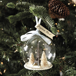 Ballard Designs - Eiffel Tower Globe Ornament - Made entirely by hand. Instant family keepsake. If you love Paris or know someone who does, it's a charming reminder of our favorite City of Lights. Tiny Eiffel Tower is flanked by flocked trees, fat bead snowflakes and glittering golden garland. The romantic scene is encased in protective clear glass.Eiffel Tower Globe Ornament features:. .