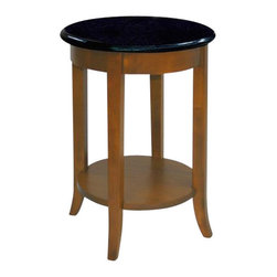 Leick Furniture - Leick Furniture Round End Table with Black Granite Top - Leick Furniture - End Tables - 9046 - Glamorous solid black granite table top, solid wood frame construction with a hand applied multi-step walnut finish to complete the look. This versatile round shaped table adds a touch of class next to your favorite chair. Lower display shelf is perfect for storing magazines or a favorite decor item. Create a sophisticated look with the matching Coffee Table sku #9045 and Console Table sku #9047.