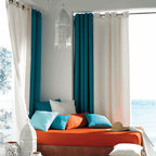 Blindsgalore Signature Drapery Panel: Sunbrella Outdoor Curtain - Made from Sunbrella's signature outdoor canvas fabric, these drapery panels are perfect for providing shade and privacy indoors and out.  Install them on sliding doors, on patios, gazeebos, cabanas and more.  Our Sunbrella outdoor drapery panels can expand your outdoor space while blocking harmful UV rays. The fabric is weather resistant for years of effective use and the stainless steel grommets are rust proof.  Available in solid colors or striped.