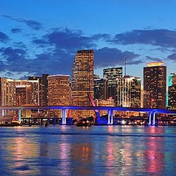 Magic Murals - Miami Night Lights Panorama Wall Mural -- Self-Adhesive Wallpaper by MagicMurals - The Miami skyline shines brightly at night as the lights reflect off the water of the Atlantic coast.  Adding to this panoramic scene is a faint halo of the sun as it sets and the blue lights of the Port of Miami / Dodge Island Bridge.