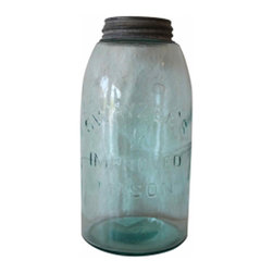 Mason Jar - Vintage canning jar with an aqua tint. We love them grouped together on a shelf, but they also make a lovely gift filled with a bouquet of wildflowers.