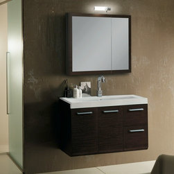 """Iotti - 38 Inch Bathroom Vanity Set - Strong lines, handsome finishes and Italian craftsmanship make this vanity set a striking choice for your bath d�cor, available in Glossy White, Wenge and Natural Oak waterproof finishes. Mirrored double doors and two shelves enhance the usefulness of the medicine cabinet. The double doors and twin drawers in the vanity cabinet have """"soft close"""" runners and closures for longer life. The fitted solid resin sink has more than five inches of shelf space at the back. Comes complete with vanity light. Set Includes: . Vanity Cabinet (2 doors, 2 drawers). Fitted ceramic sink (38.3 inch x 17.3 inch ). Medicine Cabinet (30.9 inch x 27.7 inch ). Vanity Light. Vanity Set Features:. Vanity cabinet made of engineered wood. Cabinet features waterproof panels. Available in Wenge (as shown), Natural Oak, Glossy White. Cabinet features 2 doors, 2 soft-closing drawers. Faucet not included. Perfect for modern bathrooms. Made and designed in Italy. Includes manufacturer 5 year warranty."""