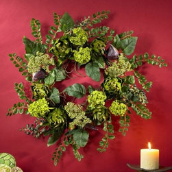 20-Inch Artichoke Floral Wreath - Even if artichokes aren't your thing the 20-Inch Artichoke Floral Wreath is a feast for anyone's eyes. Featuring brightly hued florets and shapely hearts this wreath will bring a hint of natural beauty to any space. Blooms foliage buds and berries flesh out the wreath for a full lively look. This wreath measures 20-inches diameter and will fit beautifully anywhere.