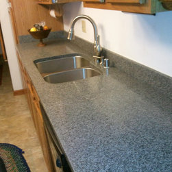 Travina Glass Series Counter top - This is a galley kitchen in an older condominium located in West Bend Wisconsin. We provided the sink and installed the counter top in an afternoon.