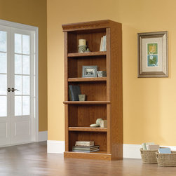 """Sauder - Orchard Hills Library Bookcase in Carolina Oak - American country style that provides endless versatility in the Orchard Hills Collection. Solid cases are softened by finely detailed moldings while warm Carolina Oak finish makes this piece the perfect accompaniment to the existing decor of any home. Features: -Library bookcase. -Orchard hills collection. -Carolina oak finish. -Three adjustable shelves. -Enclosed back with cord access. -Patented slide on moldings. -Made in USA. -Assembly required. -Manufacturer provides 5 year warranty. -Overall Dimensions: 71.5"""" H x 29.5"""" W x 13.5"""" D."""