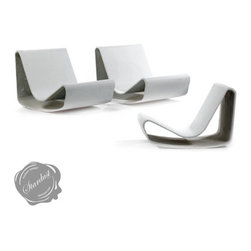 Mid-Century Modern Loop Chair: Modern Outdoor Garden Chaise - Looking for a good landscape design idea? Few outdoor furniture pieces have more visually striking design appeal than the classic mid century modern Willy Guhl Loop Chair by Stardust. This beautiful outdoor chair lends itself perfectly for a variety of applications including small inner city courtyard gardens, patio gardens, container gardens, small garden designs or larger landscape projects.